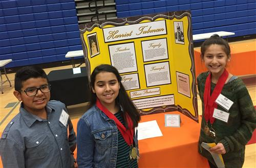 6th graders with their 2nd place exhibit
