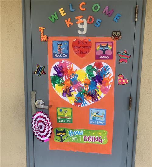 door welcoming kids back to school