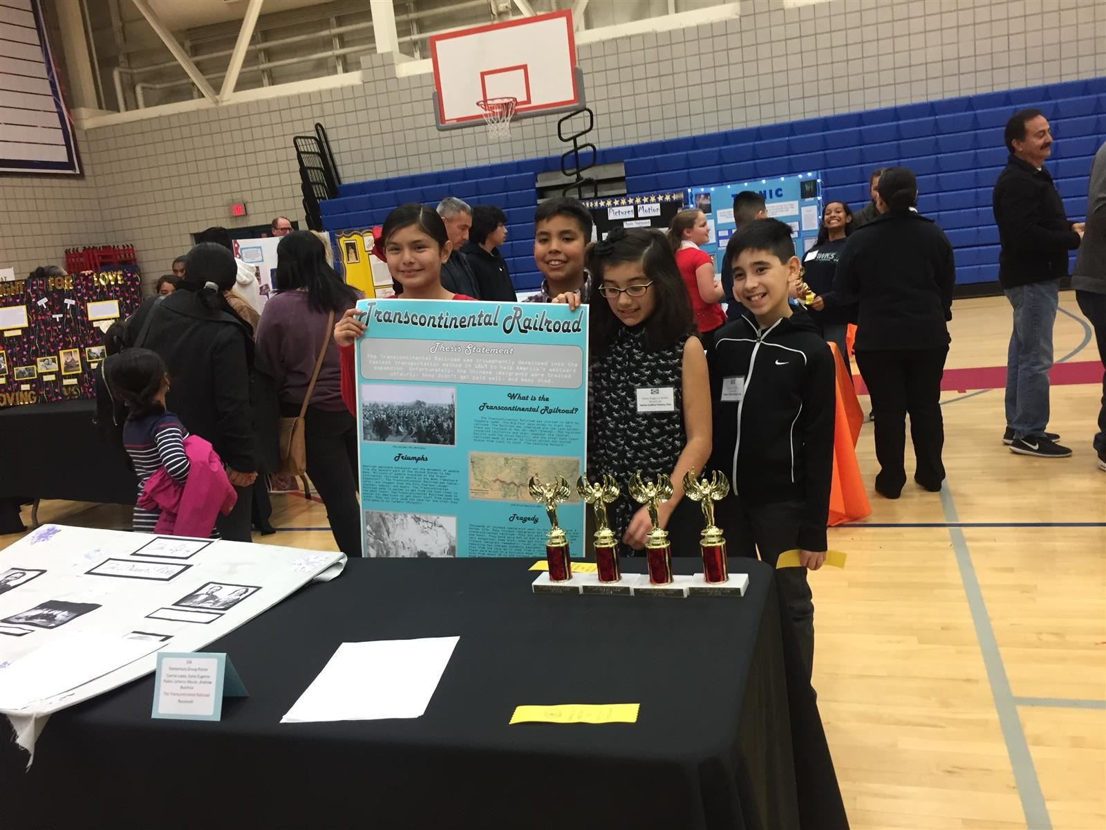 Roosevelt 4th Grade students with their 1st place poster