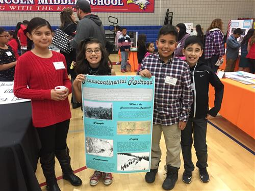4th graders with their winning poster
