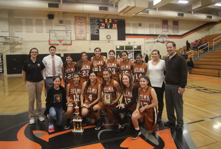 The Selma girls basketball team pose for a team picture after claiming the 44th Annual Selma Shooto